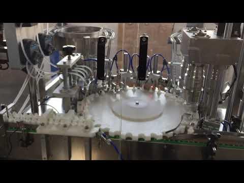tappatrice rotativa di alta precisione per industrie alimentari, salse e cosmetiche