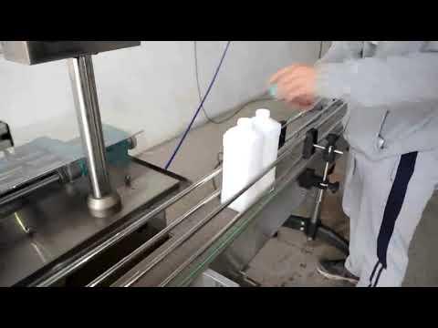 riempitrice imbottigliamento olio motore a pistoni automatici economica