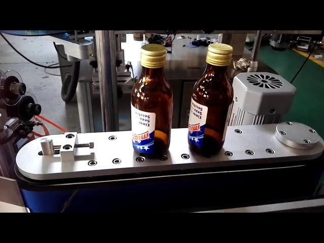etichettatrice automatica per bottiglie rotonde autoadesiva